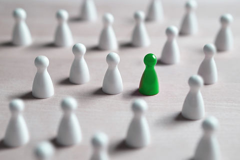 One different board game pawn. Individuality, independence, leadership and uniqueness conc