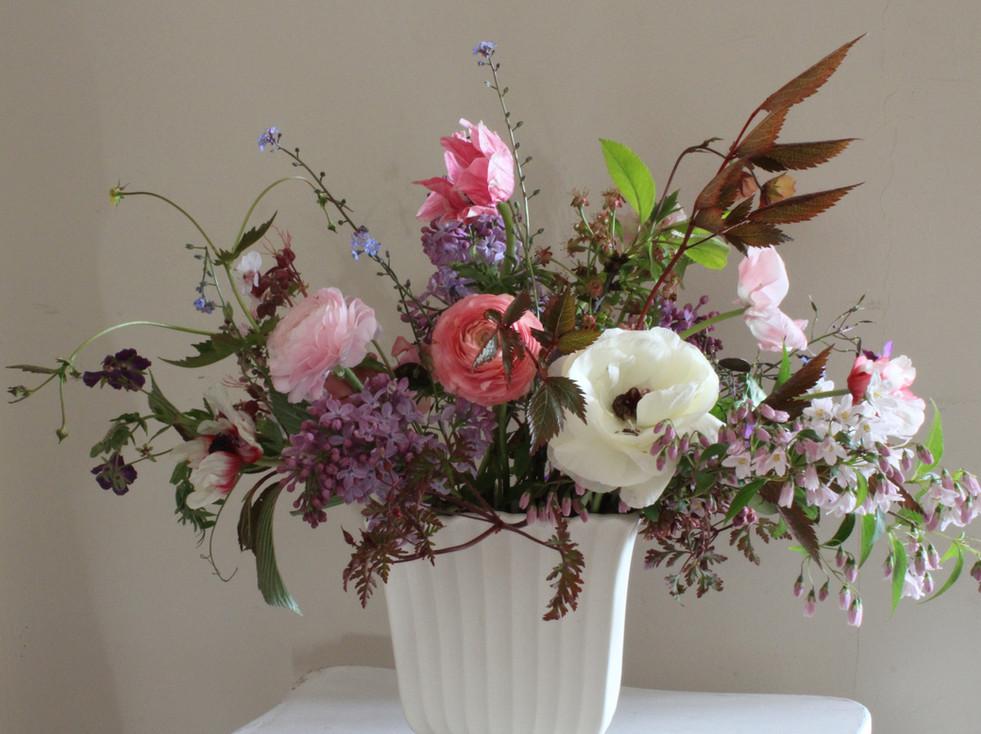 Spring flowers in flat vase