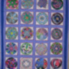 A mandala quilt created by Reaching Across participants