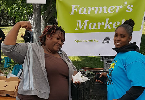 BestNow staff help coordinate the free farmer's market at the We Move for Health event at Lake Merritt, organized by the Health and Human Resource Education Center