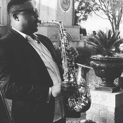 Our saxophonist Malusi playing as part of our Jazz Duo at Velmore Estate the other day
