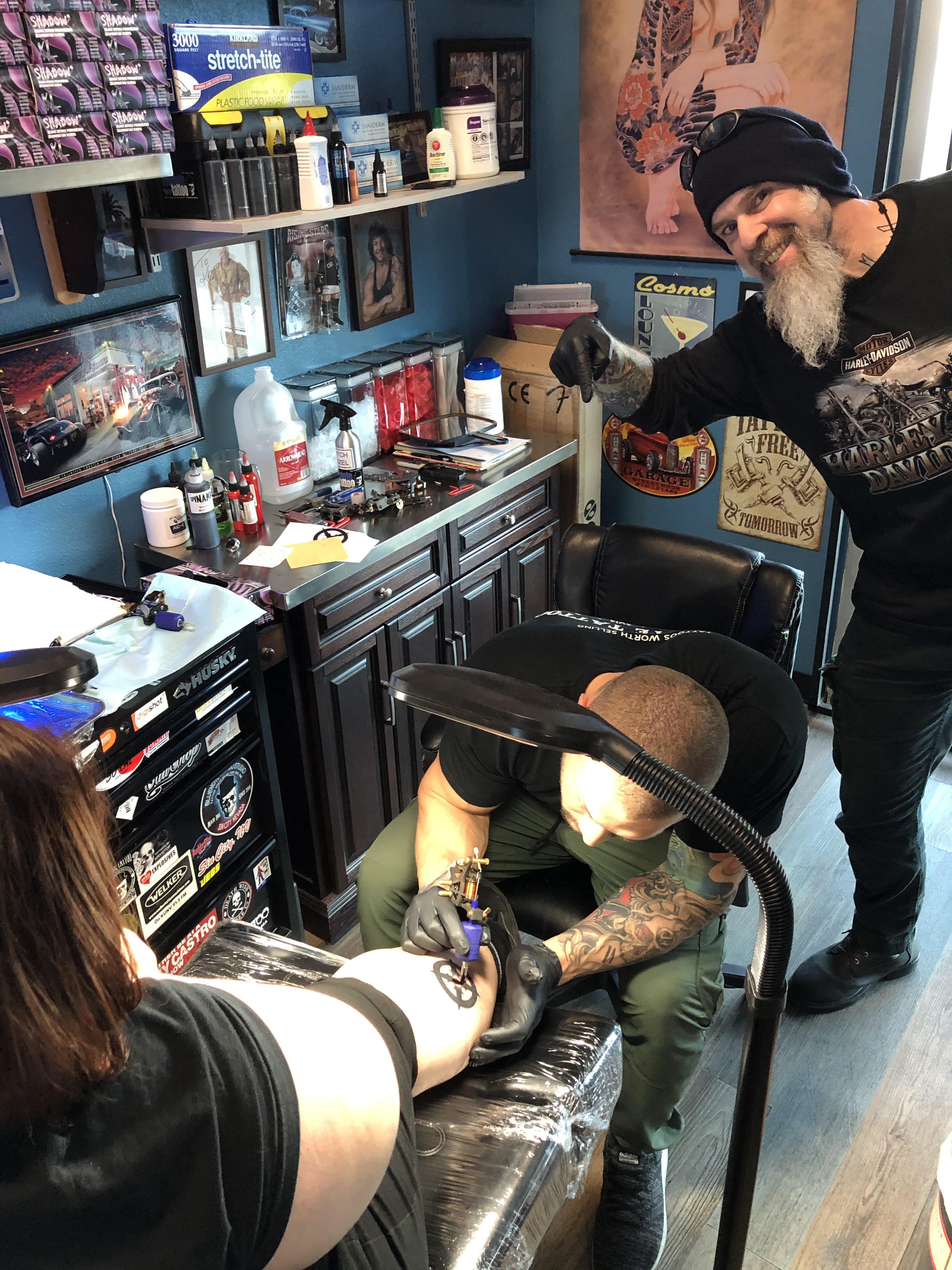 Krystof giving a Lesson in Tattooing