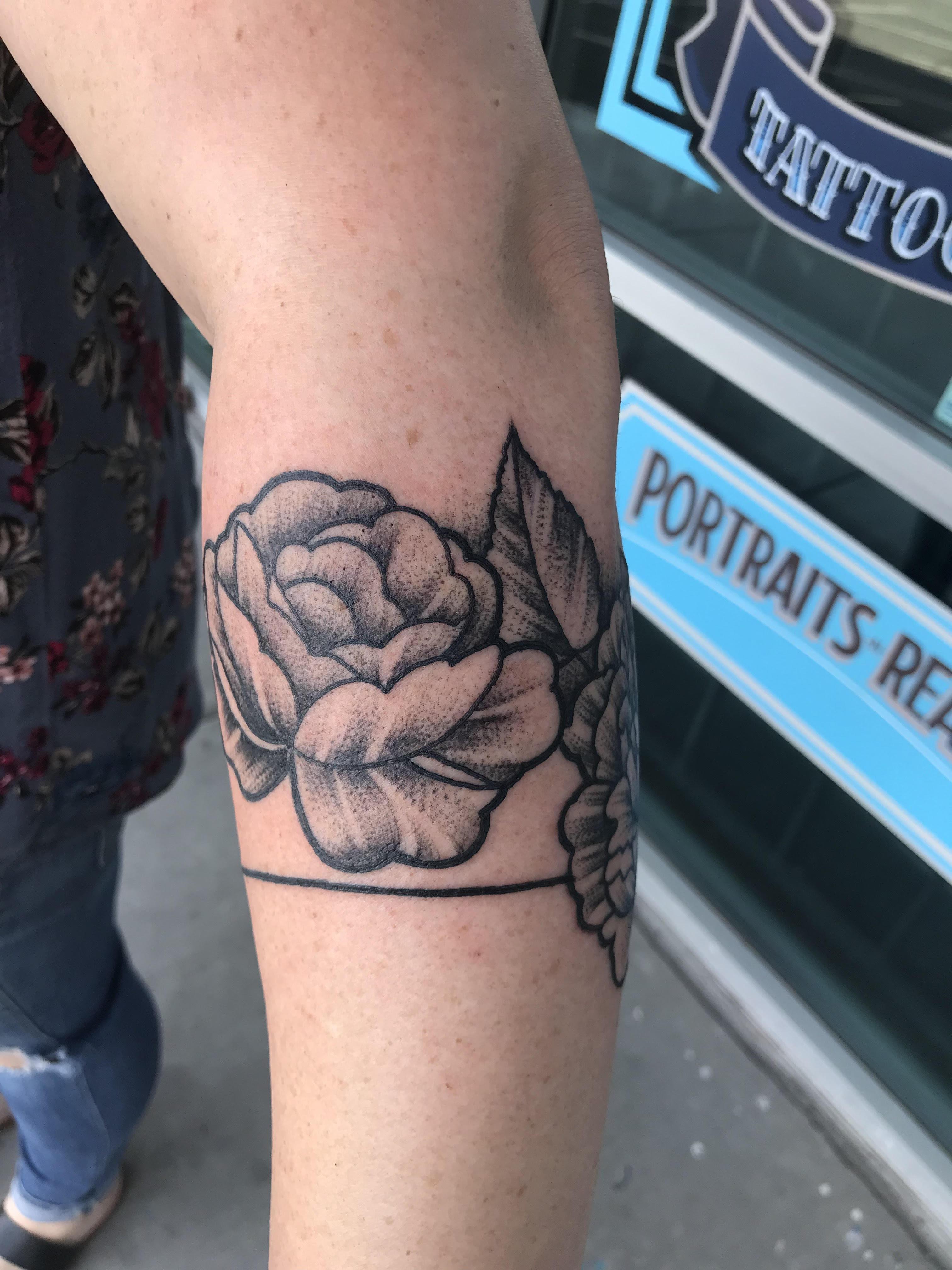 dot work flower tattoo by Krystof