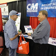 Picture of two individuals at annual conference tradeshow