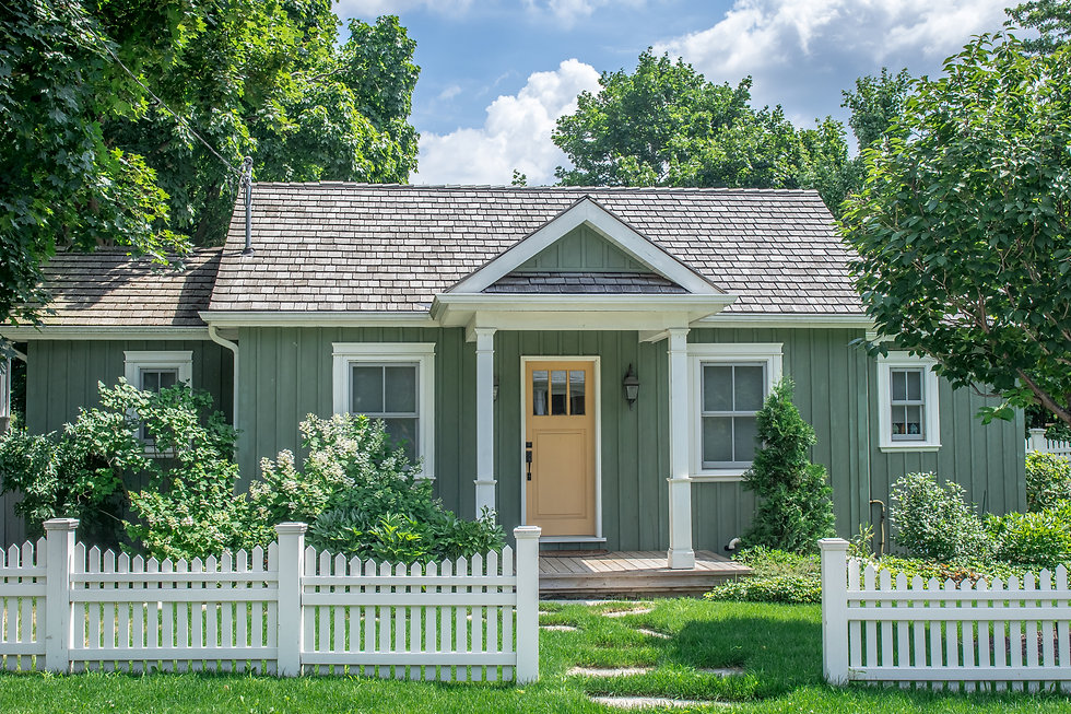 A small vintage cottage style home, in p