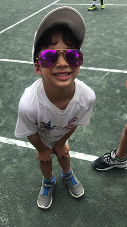 hauser boy with shades.jpg