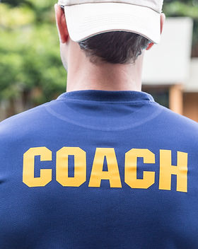back of a sport coach's blue shirt with