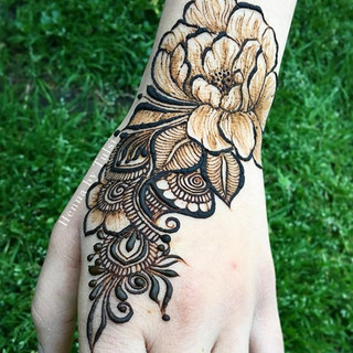 Flower inspired by various henna artists all over the place! My sister wanted a realistic flower with mehndi designs around it! It turned ou