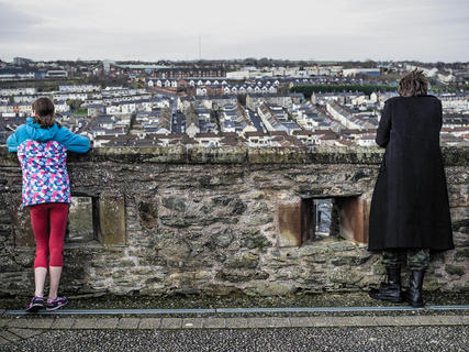 Tourists. Double Bastion. Bogside estate in the background