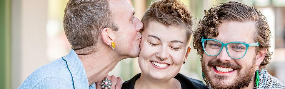 A kiss among attractive gender fluid fri