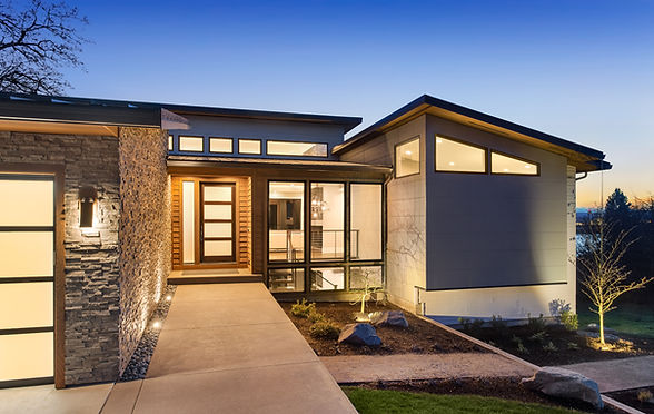 Beautiful modern style luxury home at sunset, featuring entrance and elegant design.jpg