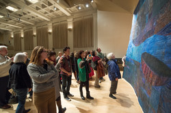 Audience viewing the art work