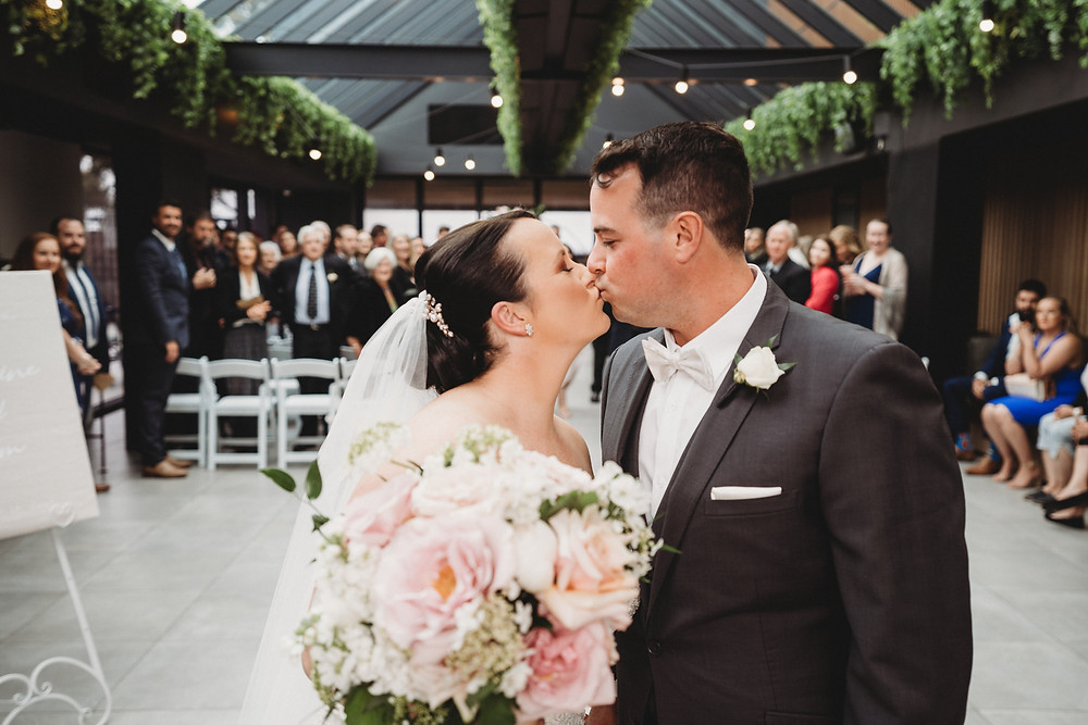 the bride and the bridegroom kissed on their wedding day