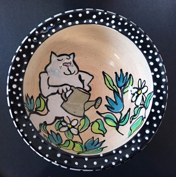 cat watering plants bowl