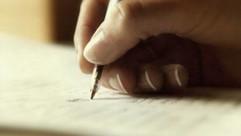 writing-in-book-1280x720.jpeg