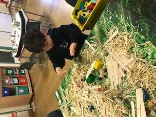 Building a stable with sticks and straw