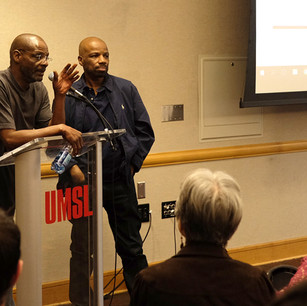 Joe Amrine see left, Reggie Griffin seen right, speaking at UMSL