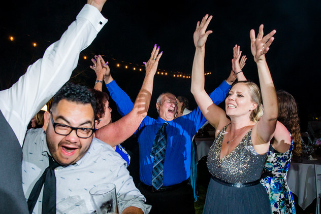 Hands up at a Lake Tahoe wedding dance party