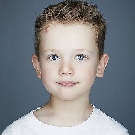 close-up portrait of child_ funny little