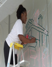 Gail lining in the chalk drawing with paint