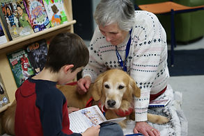 therapy dog reading with child