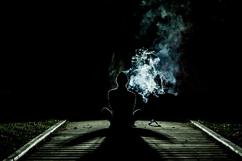 Person at Night with Smoke