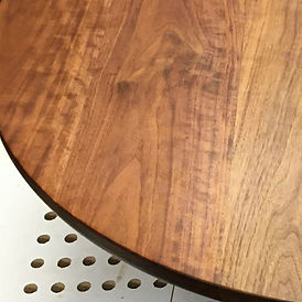 detail shot a of a modern walnut coffee table top being built in a woodshop