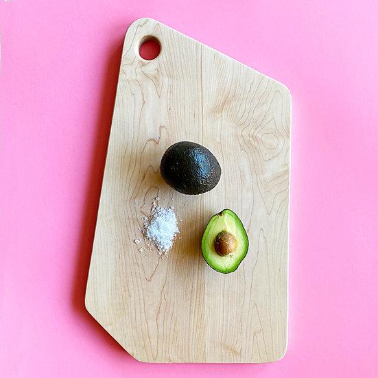 Modern maple cutting board with avocado