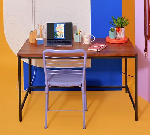 Custom walnut and black steel desk, home office with laptop, potted plants, office accessories, bright and colorful walls