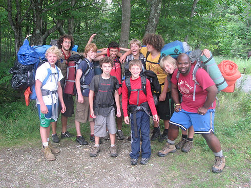 Campers and staff pose for a picutre during an overnight hike