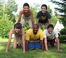 Campers and staff make a human pyramid