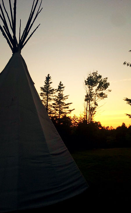 The sunset behind a Sioux tipi