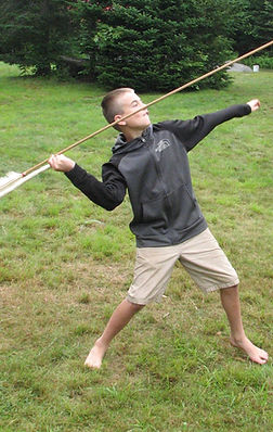 A boy throwing an atlatl
