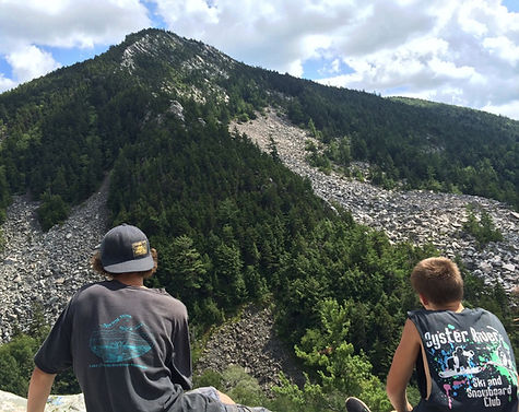 Two boys look up at White Rocks in Wallingford Vermont