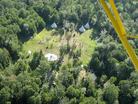 An aerial view of the Night Eagle camp clearing from a small plane