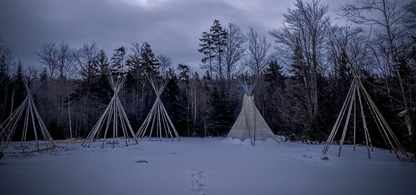 Five snow-covered tipi sites during a Vermont winter