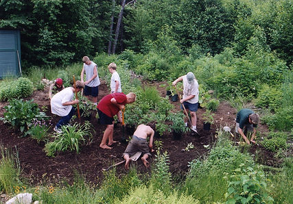 Night Eagle campers work in the garden