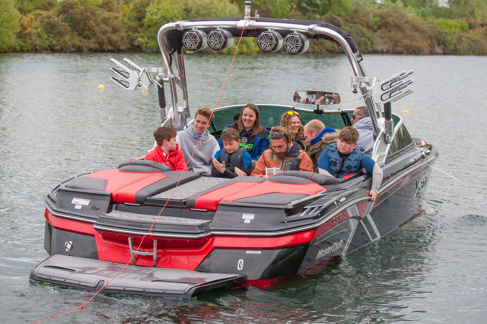 Family wakeboarding and waterskiing