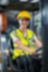 Portrait of smiling female factory worke