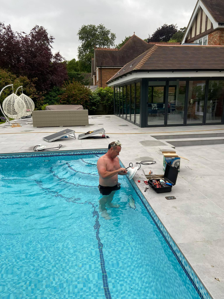 Pete the Poolman testing pool water