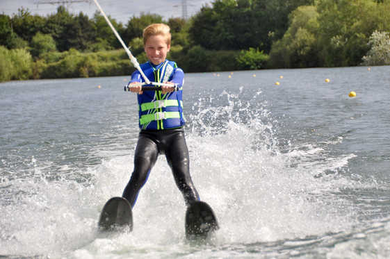 Kids learning to Waterski on two skis