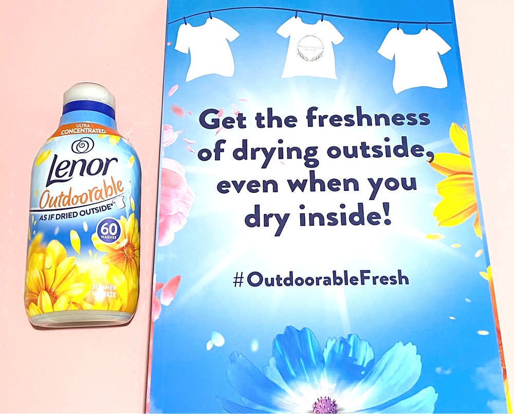 a bottle of Lenor outdoorable fabric conditioner next to the Pr packages of flowers with the saying get the freshness of drying outside, when you dry inside - for review by beautifullyoriginal.com