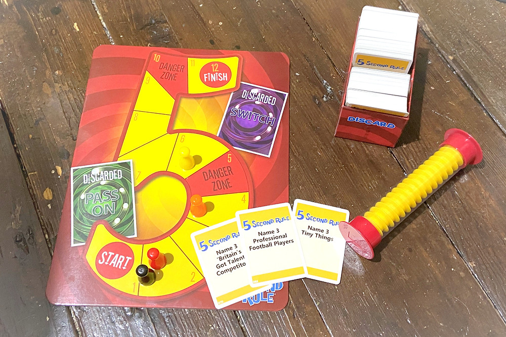 5 second rule game played with all peices across the board and the cards ready to be played.