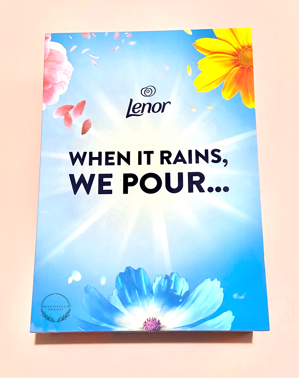 a Pr box in blue with flowersasaying Lenor whenit rains, we pour.... for review by beautifullyoriginalcom