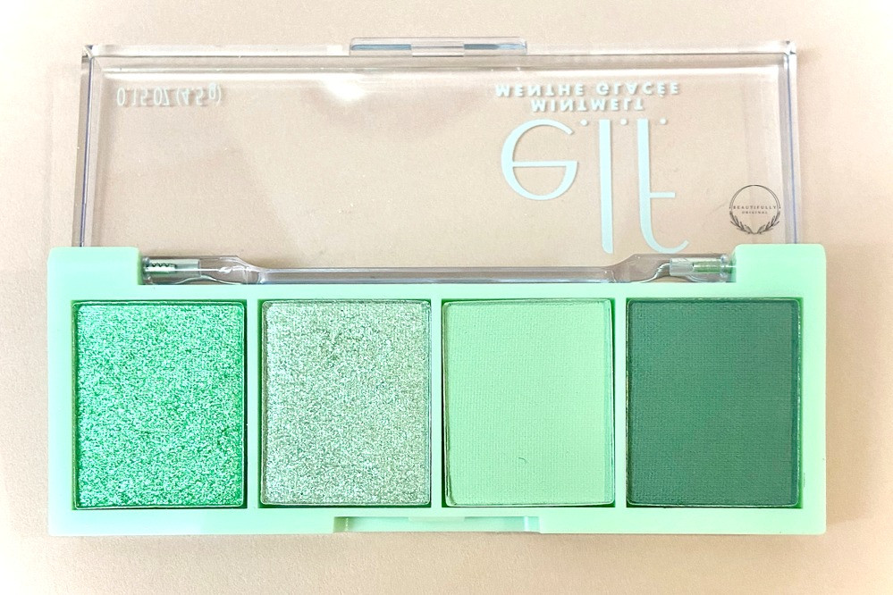 the latest eyeshadow quad from Elf cosmetics @mint to be' a selcetion of four mint shades in mint green packaging on a pink background honest review by beautifullyoriginal.com