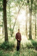 High school senior in the woods