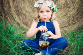 Sweet southern girl with tea and hay bales