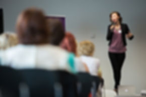 Rebecca Poole presenting at an event