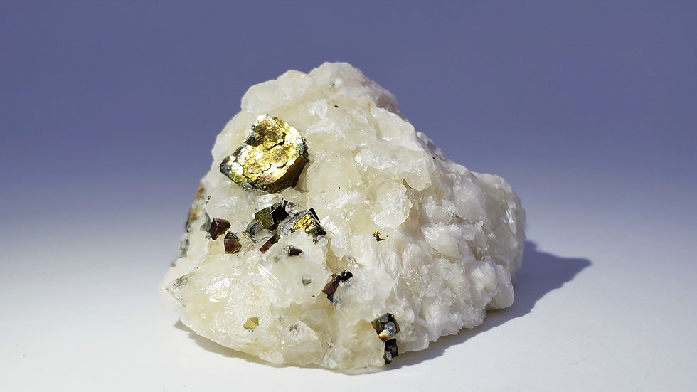 Iridescent Chalcopyrite and Pyrite on Calcite from Daye Copper Mine, China