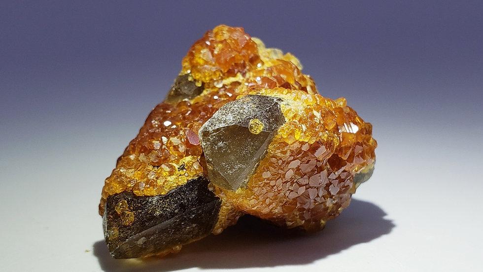Spessartine Garnet on Twin Smoky Quartz Points from Wushan Mine, China